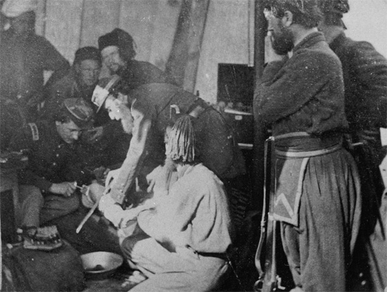 Surgeons attending to wounded soldiers during the Civil War.