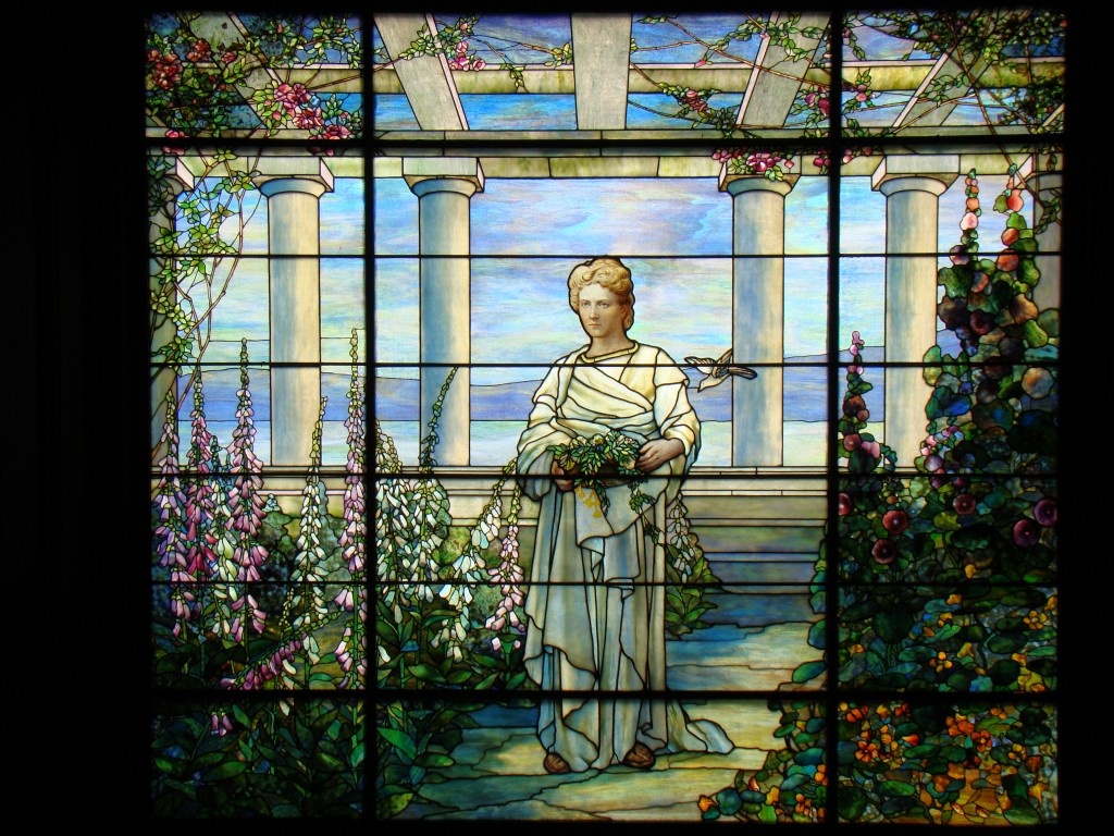 The palace's hand-painted Tiffany stained glass window bears the likeness of Mrs. Dooley.