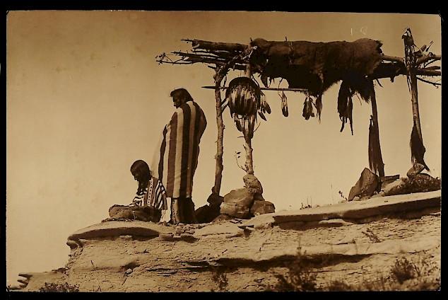 Piegan men with burial scaffold