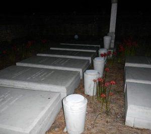 Orb near graves at night