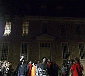 Colonial Ghost Tour Group taking photos of old Colonial Williamsburg building