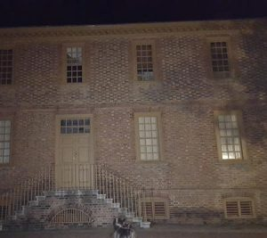Old Building with mysterious lights in Haunted Colonial Williamsburg