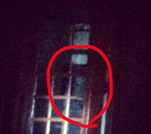 Shape in the window in a building on the Colonial Ghost Tour