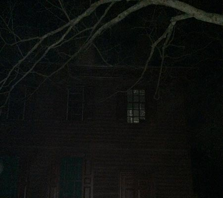 Ghost in the window during a ghost tour