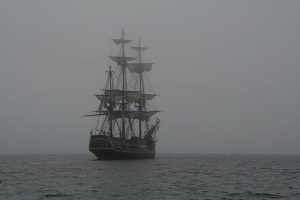 spirits and ghosts: a ghostly ship floats behind a thick fog