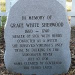 A vertical stone marker with Grace Sherwood information