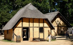 photo shows a thatched roof cottage similar to those of the first Jamestown settlement.